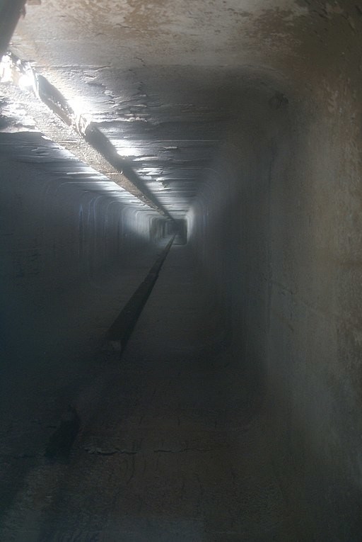 Looking down a vertical mine shaft